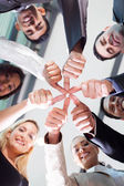 Co-workers with thumbs joined together — Stock Photo