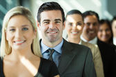 Group of business people in a row — Stock Photo