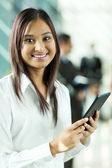 Indian office worker holding tablet computer — Stock Photo