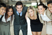 Business people huddling — Stock Photo