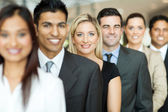 Business executives standing in a queue — Stock Photo