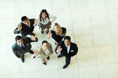 Overhead view of businesspeople waving — Stock Photo