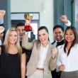 Cheerful business team winning an award — Stock Photo