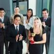 Stock Photo: Business team winning an award