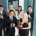 Business team winning an award — Stock Photo #28007827