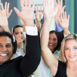 Group of business team raising hands — Stock Photo