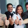 Business group giving thumbs up — Stock Photo