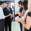 Stock Photo: Translator introducing arabian businessman