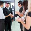 Translator introducing arabian businessman — Stock Photo #28008473