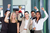 Cheerful business team winning an award — Stock Photo