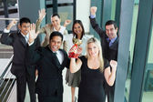 Young business people wining a trophy — Stock Photo