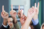 Business group raising hands — Stock Photo