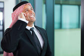 Muslim businessman talking on cell phone — Stock Photo