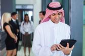 Saudi arabian businessman using tablet computer — Stock Photo