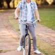 Teenage boy riding a bicycle — Stock Photo #28179509