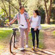 Young teenage couple walking at the park — Stock Photo #28179859