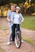 Teenage couple riding bicycle together — Stock Photo
