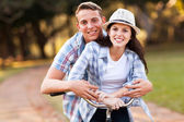 Teenage couple riding bicycle — Stock Photo