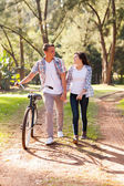 Young teenage couple walking at the park — Stock Photo