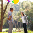 Romantic teen boy with helium balloons — Stock Photo #28180971
