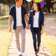Teenage couple walking at the park — Stock Photo