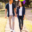 Teenage couple walking at the park — Stock Photo #28182121