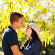 Teenage couple hugging outdoors — Stock Photo