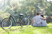 Back view of teenage couple sitting outdoors — Stock Photo