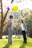 Romantic teen boy with helium balloons — Stock Photo