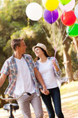 Cute teen couple walking at the park — Stock Photo