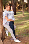 Teenage couple embracing — Stok fotoğraf