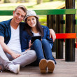 Loving teen couple with tablet computer outdoors — Stock Photo