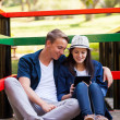 Teenage couple using tablet computer — Stock Photo