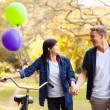 Teenage couple walking in park — Stock Photo