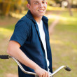 Smiling teenage boy with bike — Stock Photo