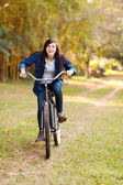 Cute teenage girl riding a bicycle — Stock Photo