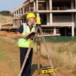 Middle aged land surveyor working at construction site — Stock Photo