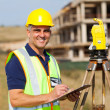 Stock Photo: Senior land surveyor
