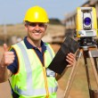 Land surveyor giving thumb up — Stock Photo