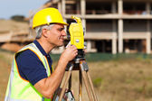 Senior land surveyor working with theodolite — Stock Photo