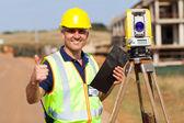 Land surveyor giving thumb up — Stock Photo