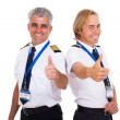 Airline pilots giving thumbs up — Stock Photo