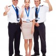 Pilots and airhostess waving — Stock Photo #28704429