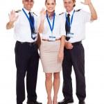 Pilots and airhostess waving — Stock Photo
