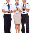 Stock Photo: Group of airline crew applauding