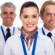 Stock Photo: Flight attendant standing in front of pilots