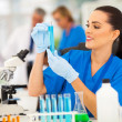 Young female scientist working with liquids in laboratory — Stock Photo #28706859