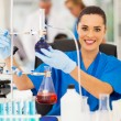 Stock Photo: Female scientist in a chemistry laboratory