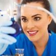 Stock Photo: Beautiful young scientist working in lab