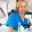 Lab technician in laboratory — Stock Photo